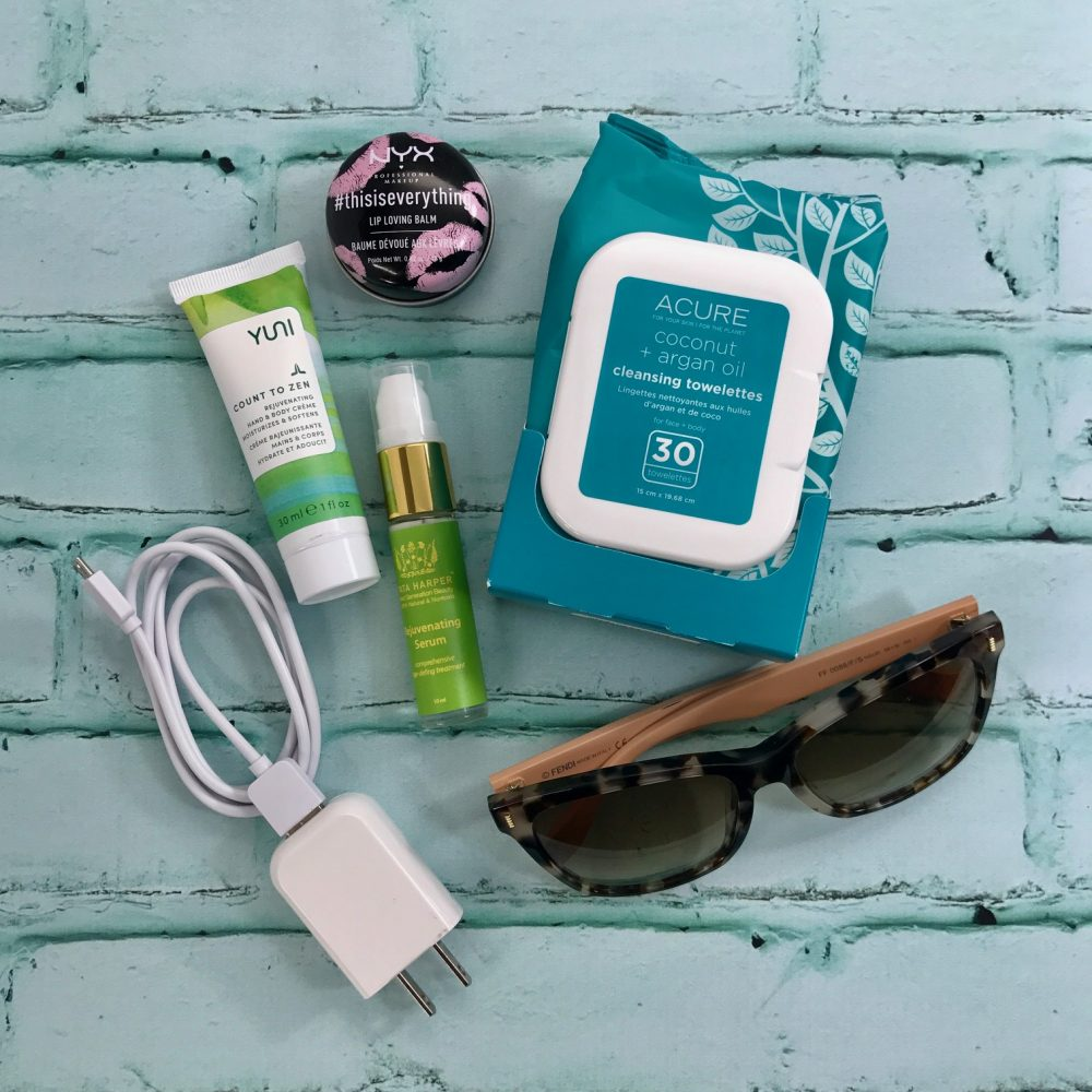 travel products, iPhone charger, sunglasses, nyx lip loving balm, acute cleansing towelettes, yuni count to zen, Tata harper rejuvenating serum